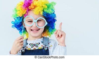 Girl in wig raising pointing finger