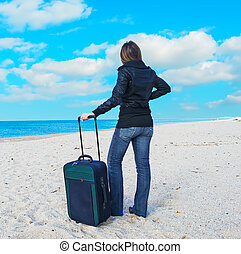 girl in winter clothes with suitcase