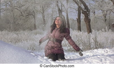 Girl in winter forest - In snowy winter forest girl whirls...