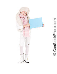 girl in winter hat with blank board