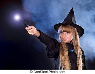 Girl in witch's hat with magic wand. - Girl in witch's hat ...