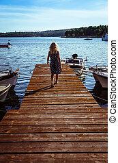 girl in wooden jetty