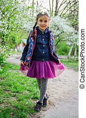 Girl in wreath enjoying spring garden
