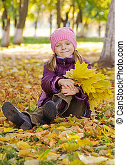 Girl in yellow autumn leaves