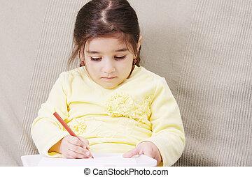 Girl in yellow drawing