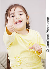 Girl in yellow with thumb up
