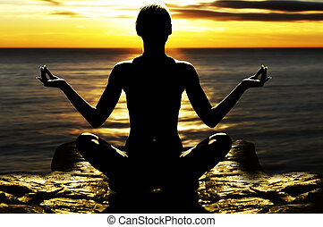 girl in yoga pose - silhouette of woman on rock in the ...