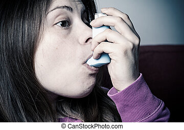 girl inhales medicine
