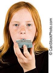 Girl inhaling asthma medicine - Young girl inhaling an...