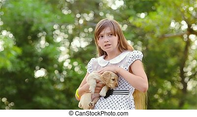 Girl irons a puppy on hands