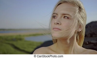 Girl is breathing fresh air - Sensual catching blond girl is...