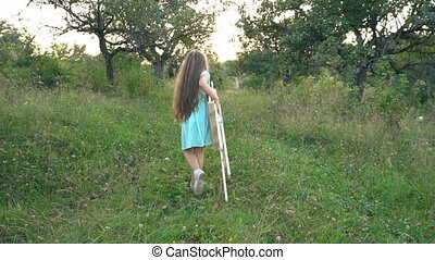girl is carrying an easel for drawing - girl in nature is...