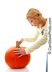 Girl is cutting in big pumpkin