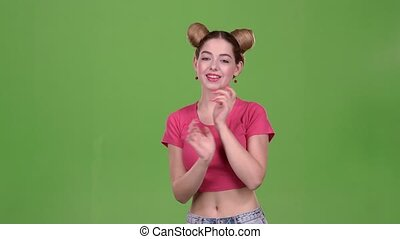 Girl is dancing energetic movements. Green screen