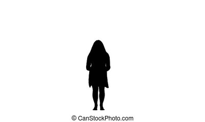 Girl is dancing energetically, having fun. White background. Silhouette. Slow motion