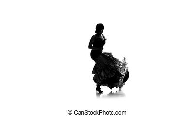 Girl is dancing in a beautiful dress with castanets . White background. Silhouette