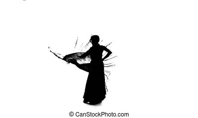 Girl is dancing with a manton in her hands. White background. Silhouette