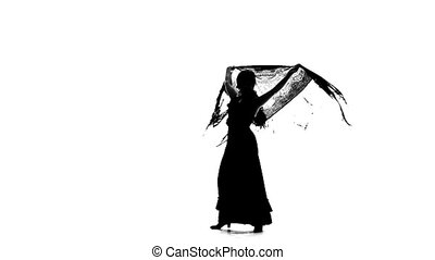 Girl is dancing with a manton . White background. Silhouette. Slow motion