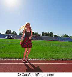girl is doing sports at the stadium