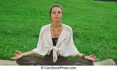 Girl is doing the main pose of yoga