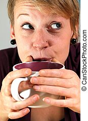 girl is drinking from a cup