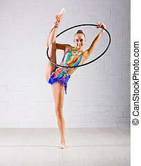 Girl is engaged in art gymnastics - Young girl is engaged in...