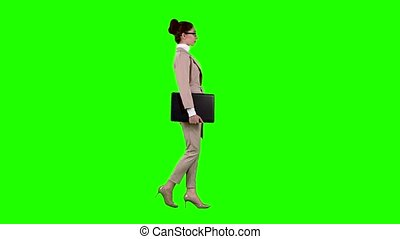 Girl is going to a meeting with a laptop in her hands. Green screen. Side view