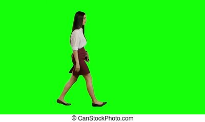 Girl is going to an important meeting, talking on the phone, she is angry. Green screen