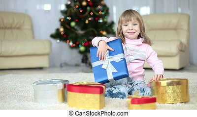 Girl is holding a Christmas gift