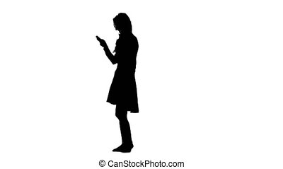 Girl is holding a phone in her hands and smiling. White background. Silhouette