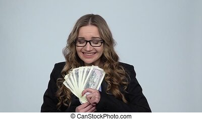Girl is holding passport, plane ticket and money very...
