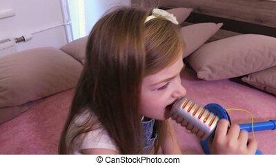 Girl is imitating singing