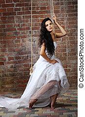 Girl is in wedding dress