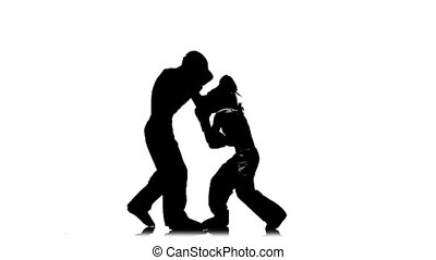 Girl is kicking the guy they are sparring for kickboxing ....