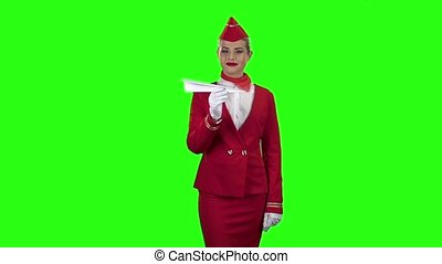 Girl is launching a paper airplane. Green screen. Slow...