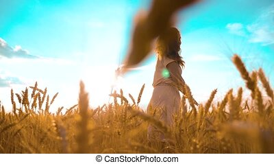 girl is lifestyle walking along the wheat field nature slow...