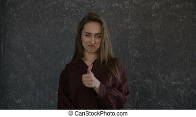 Girl is looking with thumb up