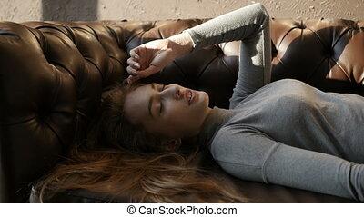 Girl is lying on the sofa
