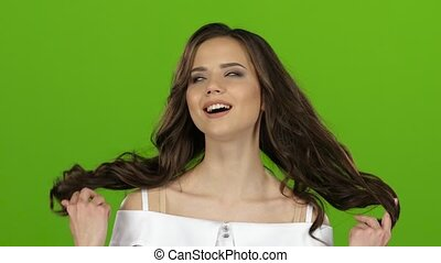 Girl is making faces, she is happy and carefree. Green screen. Close up