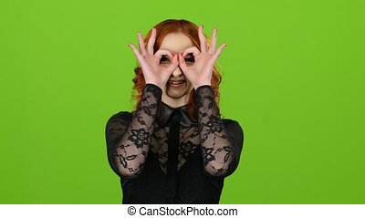 Girl is making faces, she is happy and carefree. Green screen