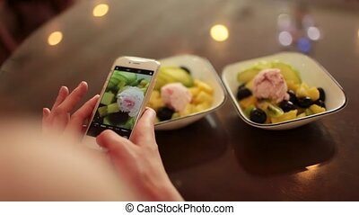 girl is photographed on the phone food