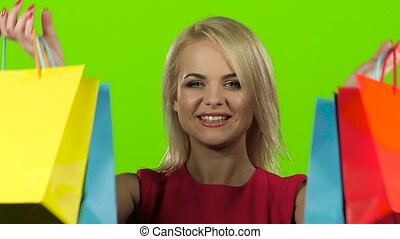 Girl is pleased with her purchases. Green screen, slow motion