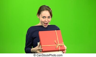Girl is pleased with the gift. Green screen