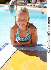 girl is posing in swim pool