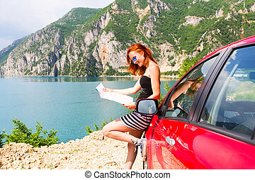 Girl is reading a map