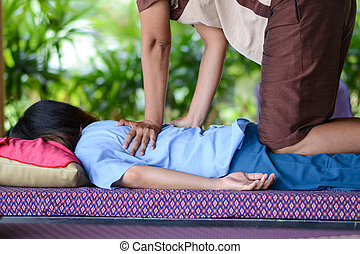 girl is relaxing from massage by professional therapists,...