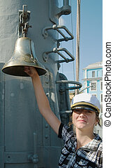 girl is ring the bell of cruiser - female tourist is ring...