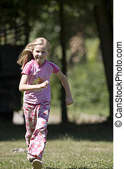 girl is running in the park