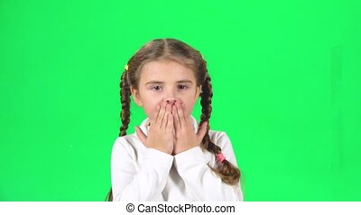 Girl is sending air kisses and smiling on green screen. Slow...