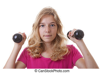Girl is sporting with dumbbells over white background